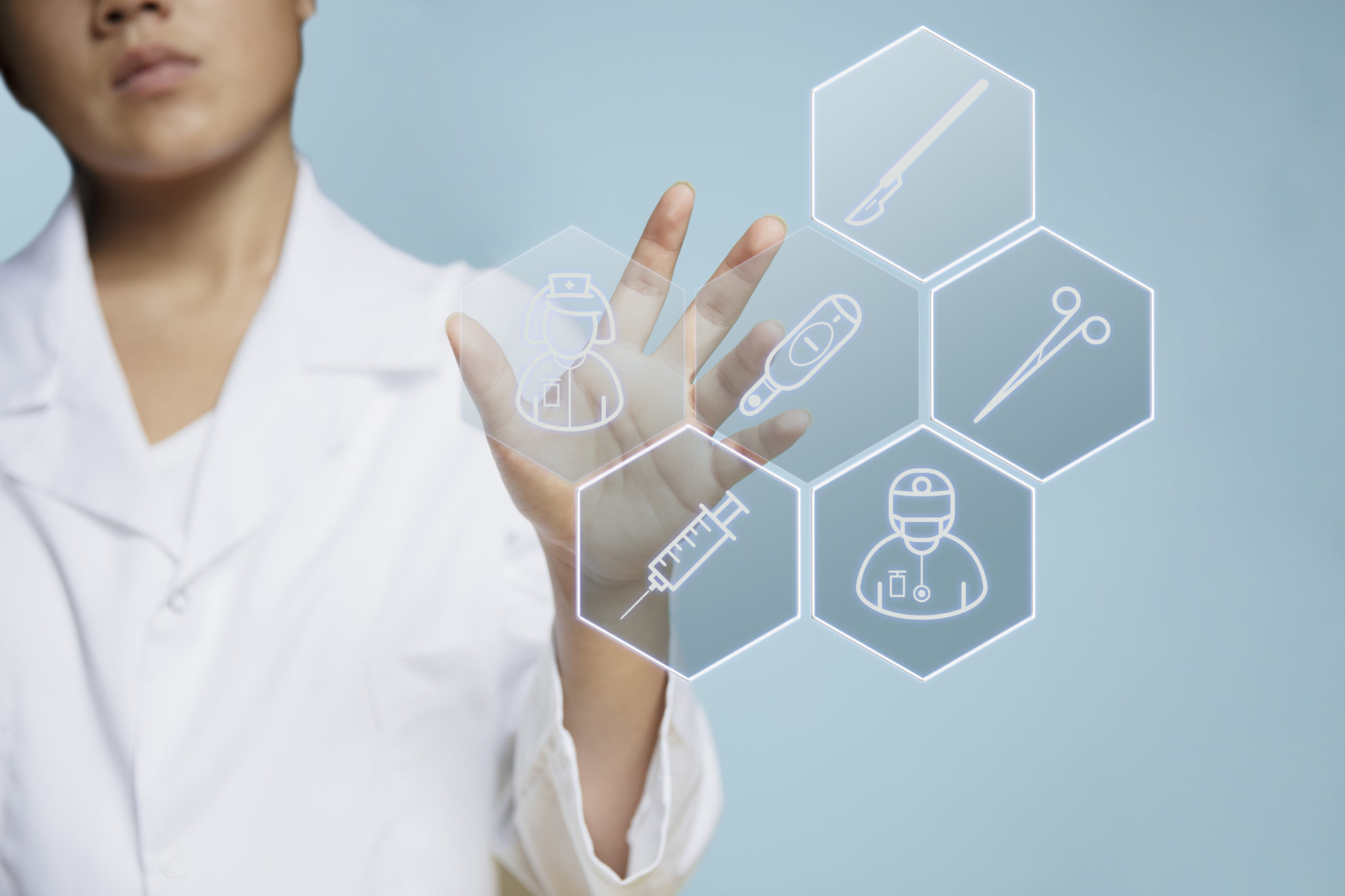 Person using IoT device in the healthcare, pharmaceutical, biotechnology industries.