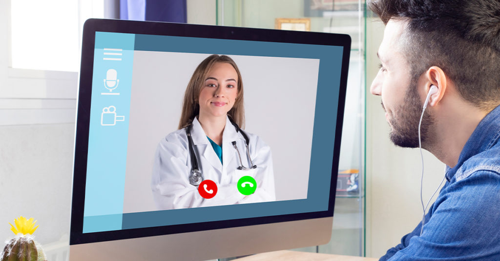 Patient talking to his doctor on video chat telemedicine